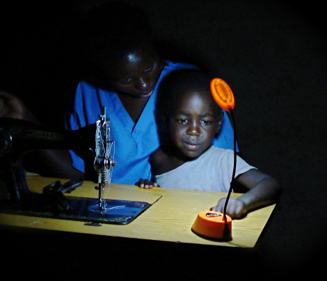 A Barefoot Power solar lamp being used in Uganda