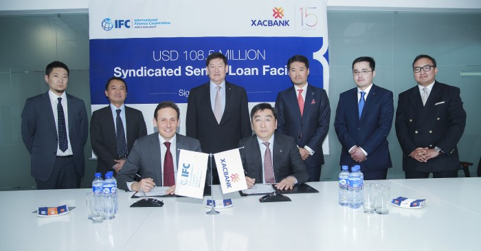 XacBank and IFC representatives during the signing ceremony