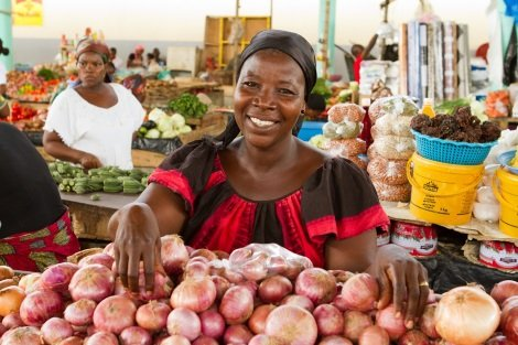 Zian Lou Bonan is a vendor selling various fruits and vegetables at the Cocovico market in Abidjan, Ivory Coast.