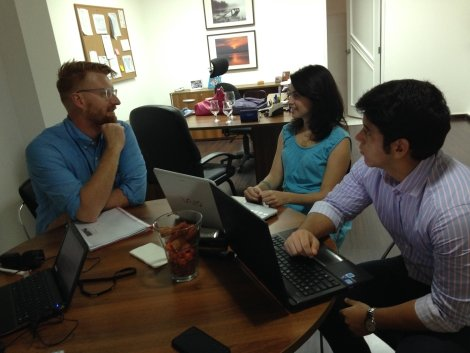 Stuart, Laura, and Alejandro working at Oikocredit DR office
